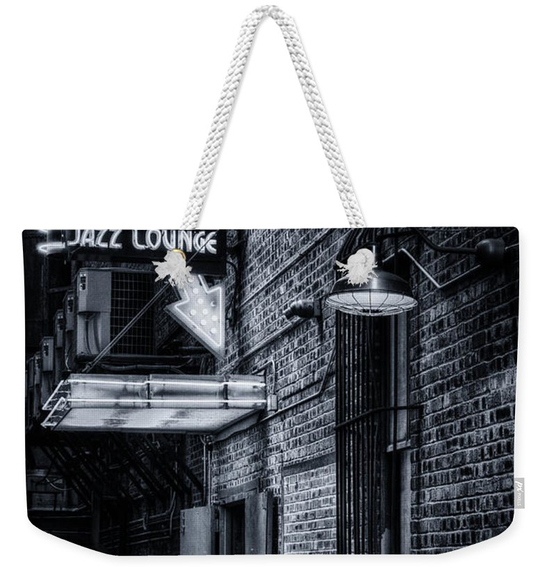 Scat Lounge Weekender Tote Bag featuring the photograph Scat Lounge In Cool Black And White by Joan Carroll