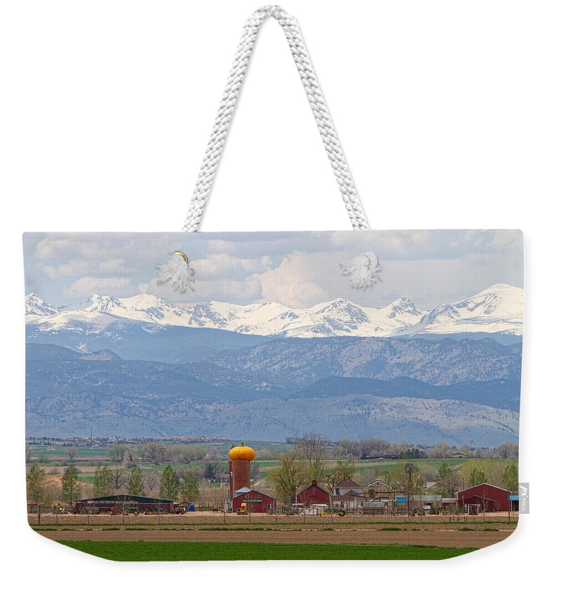 Scenic Weekender Tote Bag featuring the photograph Scenic View Looking Over Anderson Farms Up To Rockies by James BO Insogna