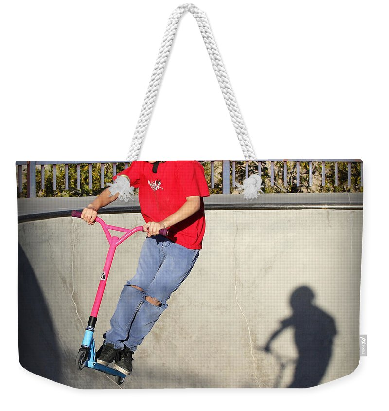 Concrete Weekender Tote Bag featuring the photograph Sport - Scooter Flying by Kip Krause