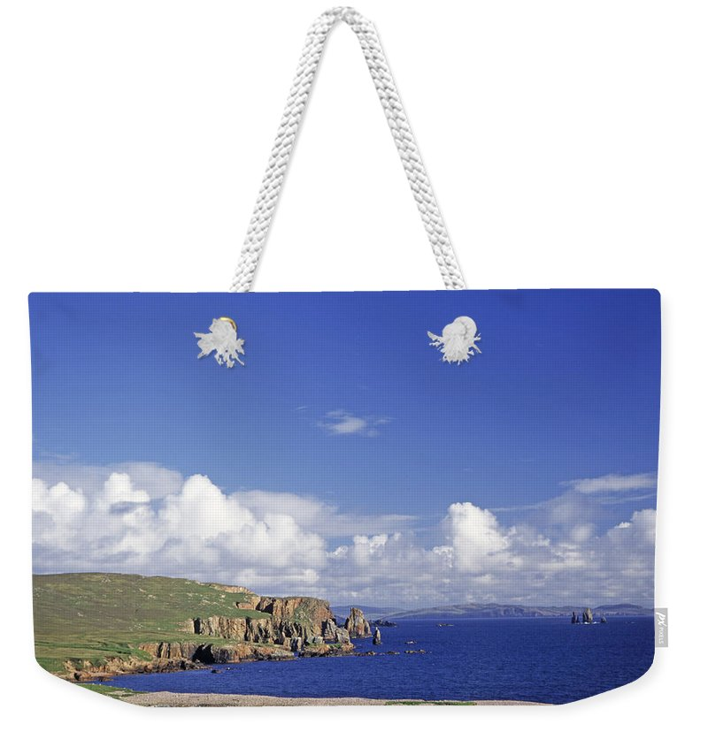 Scotland; Cloud; Landscape; Tranquility; Scenics; Horizon Over Water; Sea; Coastline; Travel; No People; Horizontal; Outdoors; Day; Eshaness Cliffs; Shetland Islands Weekender Tote Bag featuring the photograph Scotland Shetland Islands Eshaness Cliffs by Anonymous