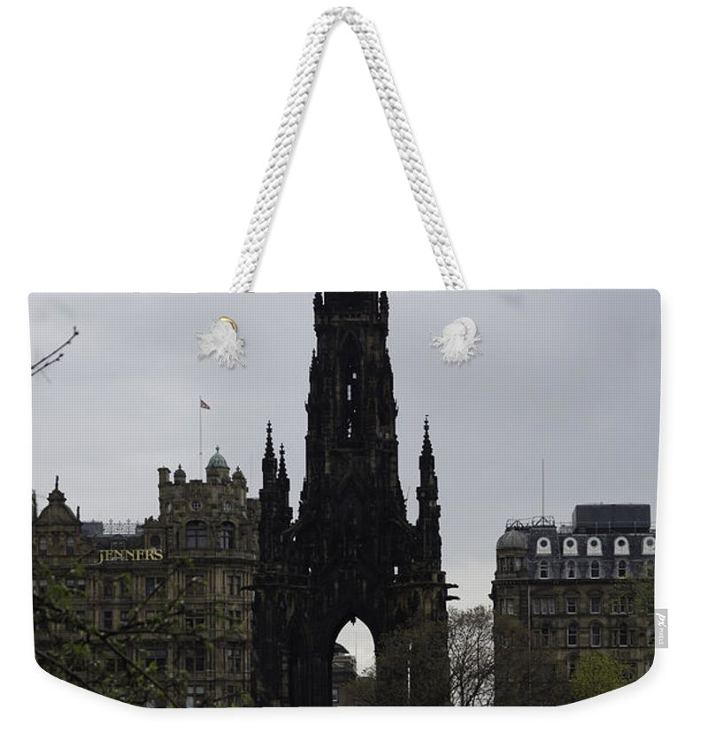 Action Weekender Tote Bag featuring the photograph Scott Monument Inside The Princes Street Gardens In Edinburgh by Ashish Agarwal