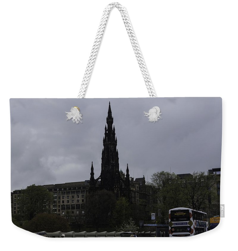 Action Weekender Tote Bag featuring the photograph Scott Monument Next To Waverley Train Station And With Sightseeing Buses by Ashish Agarwal