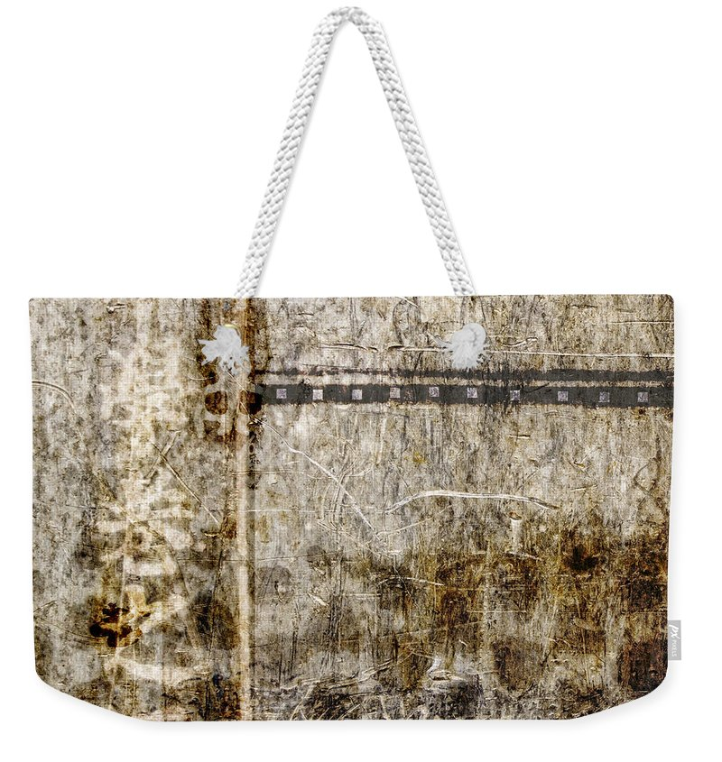 Abstract Weekender Tote Bag featuring the photograph Scratched Metal And Old Books Number 1 by Carol Leigh