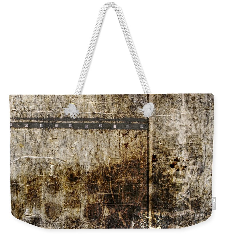 Abstract Weekender Tote Bag featuring the photograph Scratched Metal And Old Books Number 2 by Carol Leigh