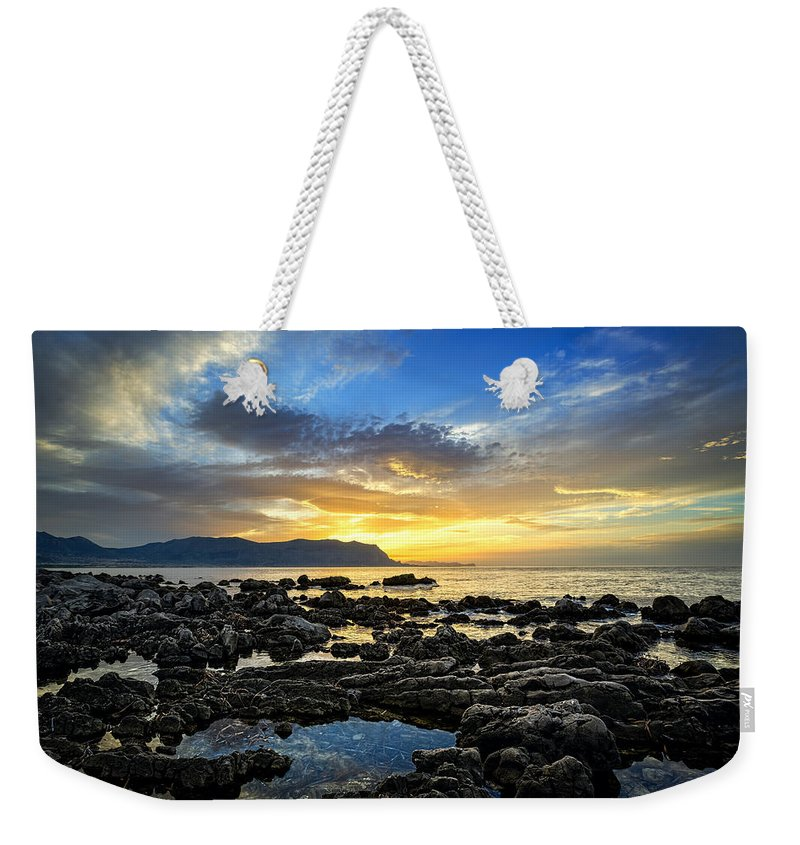 Sunset Weekender Tote Bag featuring the photograph Scurata by Ian Good