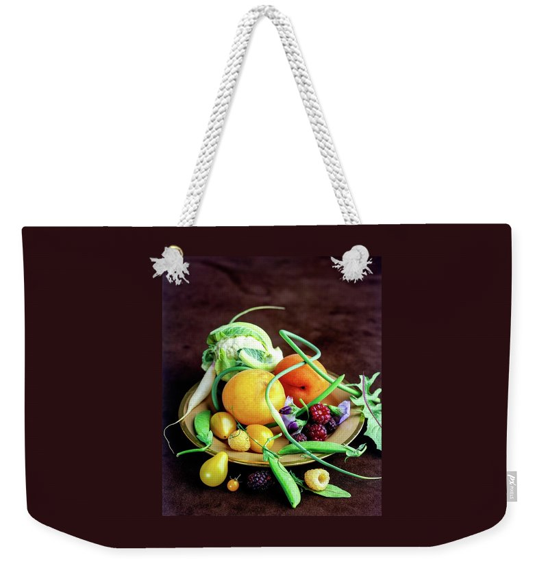Fruits Weekender Tote Bag featuring the photograph Seasonal Fruit And Vegetables by Romulo Yanes