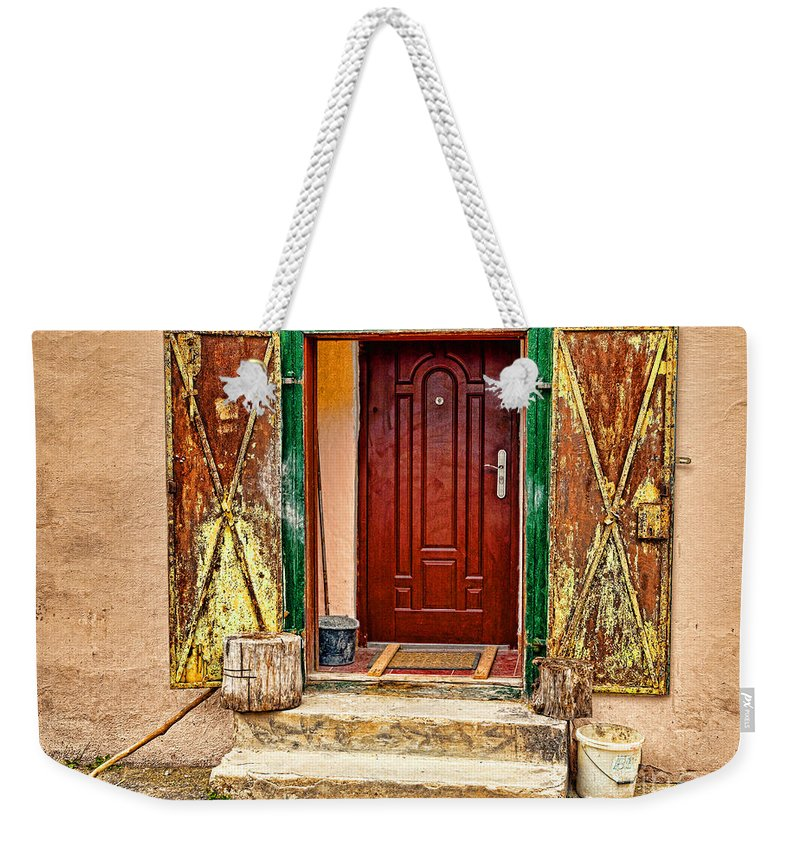 Old.weathered Weekender Tote Bag featuring the photograph Secure Entrance by Les Palenik