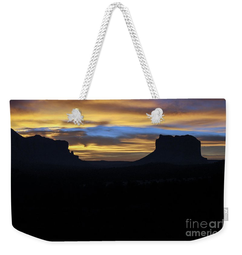 Sedona Arizona Butte Buttes Rock Formations Formations Rocks Sunrise Sunrises Landscape Landscapes Silhouette Silhouettes Weekender Tote Bag featuring the photograph Sedona Sunrise by Bob Phillips