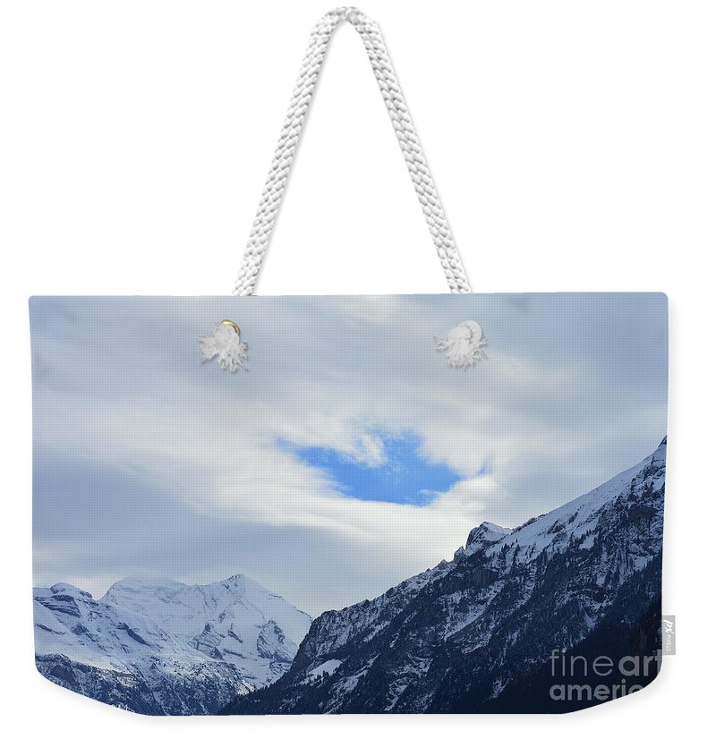Alps Weekender Tote Bag featuring the photograph Seeing Through by Felicia Tica