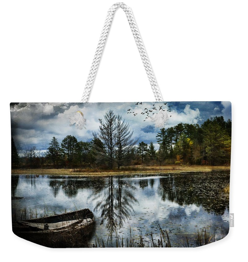 Evie Weekender Tote Bag featuring the photograph Seney And The Rowboat by Evie Carrier
