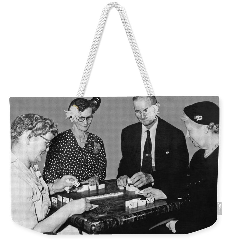 1950's Weekender Tote Bag featuring the photograph Seniors Playing Dominos by Underwood Archives