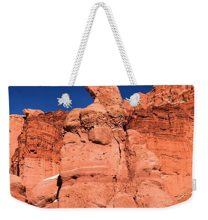 Fisher Towers Weekender Tote Bag featuring the photograph Serpent On The Cliff by Adam Jewell