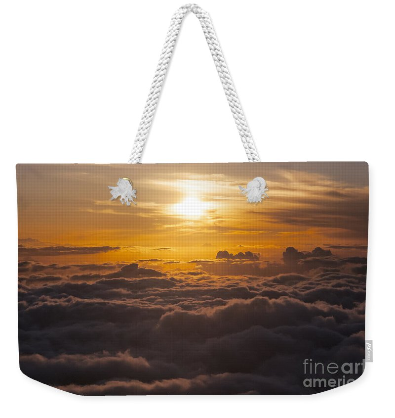 Haleakala National Park Volcano Area Maui Hawaii Evening Sky Skies Cloud Clouds Sunset Sunsets Sun Cloud Clouds Parks Weekender Tote Bag featuring the photograph Setting Sun Above The Clouds by Bob Phillips