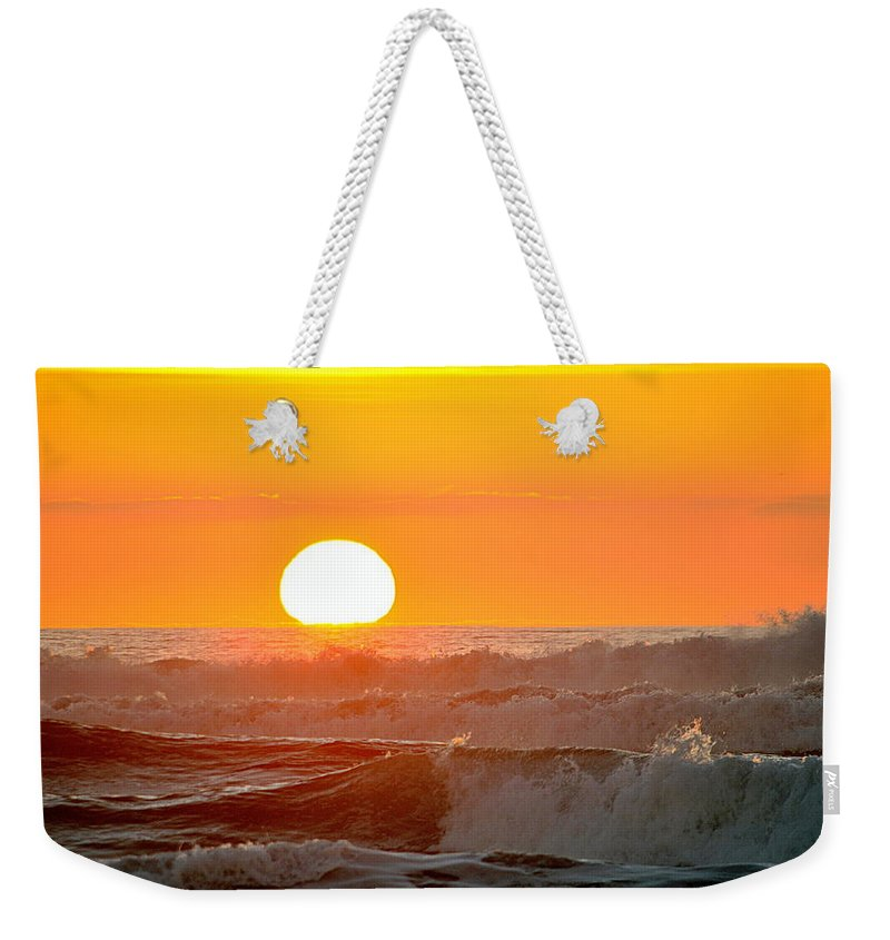 Scenic Weekender Tote Bag featuring the photograph Setting Sun And Crashing Waves by AJ Schibig