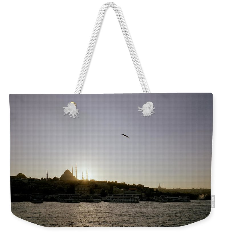Istanbul Weekender Tote Bag featuring the photograph Setting Sun Over Istanbul by Shaun Higson