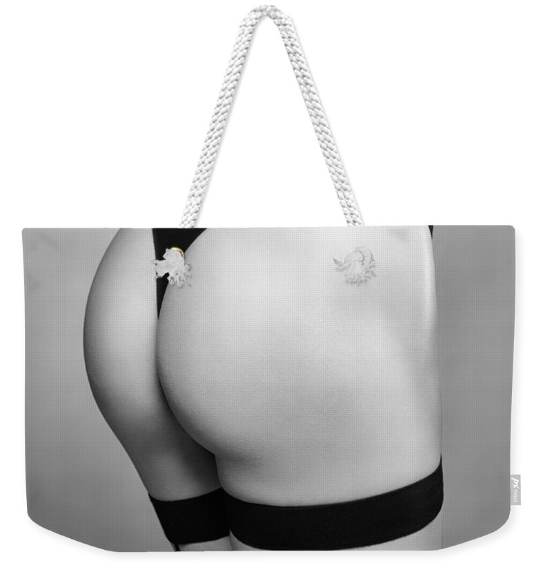 Sexy Weekender Tote Bag featuring the photograph Sexy Woman Wearing Stockings With Suspenders Closeup Black And W by Oleksiy Maksymenko