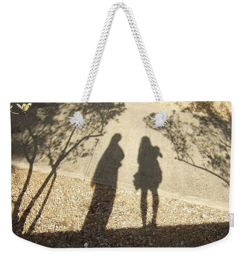 Weekender Tote Bag featuring the photograph Shadow Friends by Katerina Naumenko