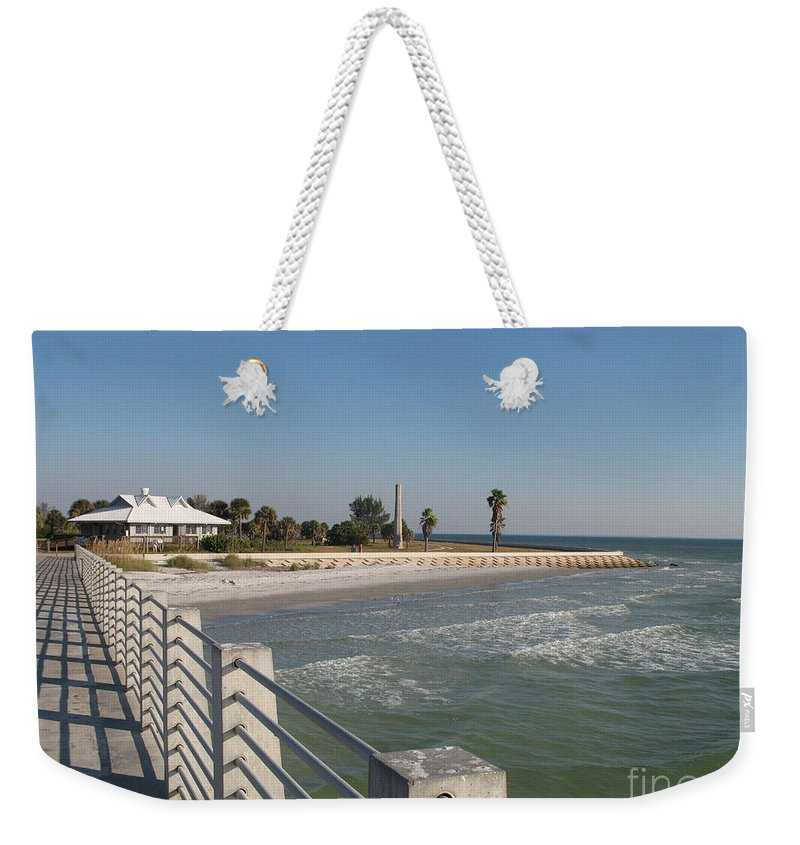Pier Weekender Tote Bag featuring the photograph Shadow On The Pier by Christiane Schulze Art And Photography