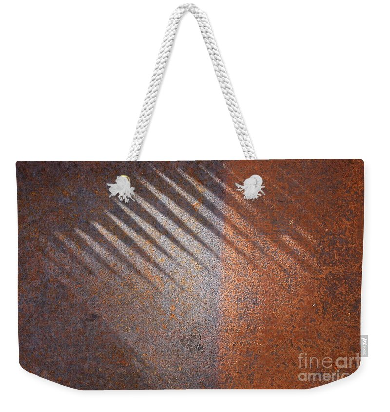 Rust Weekender Tote Bag featuring the photograph Shadows And Rust by Carol Groenen