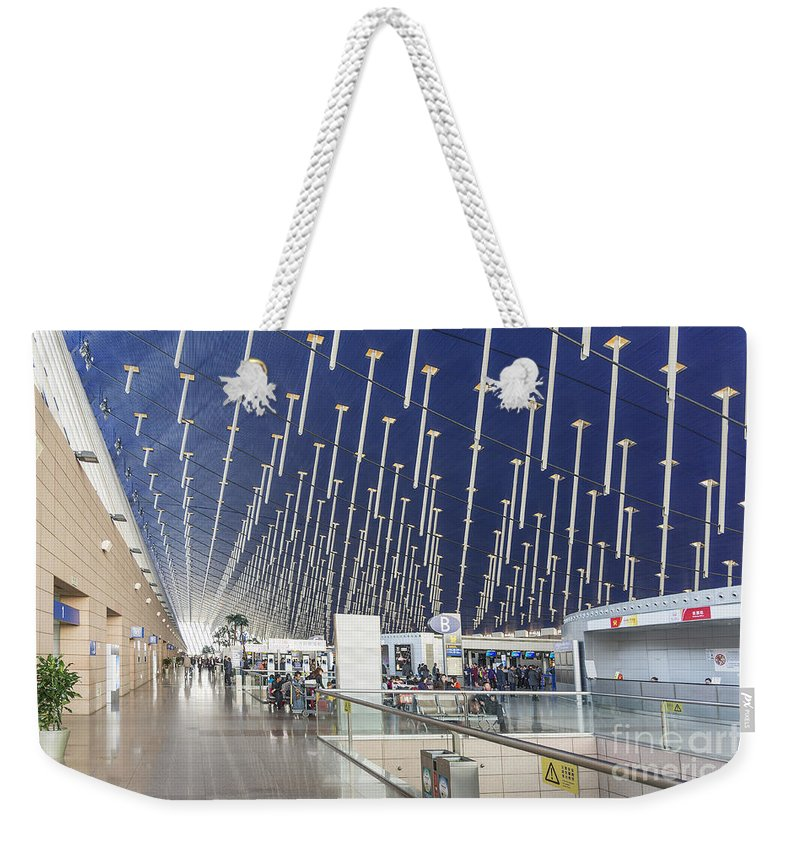 Airport Weekender Tote Bag featuring the photograph Shanghai Pudong Airport In China by Jacek Malipan