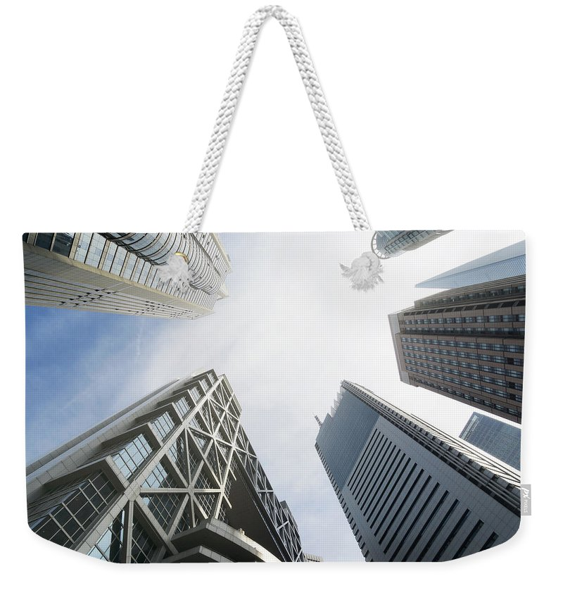 Downtown District Weekender Tote Bag featuring the photograph Shanghai Stock Exchange,china - East by Zyxeos30