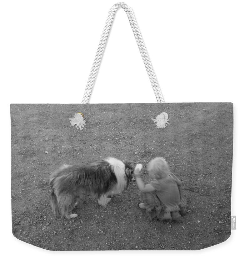 David S Reynolds Weekender Tote Bag featuring the photograph Sharing by David S Reynolds