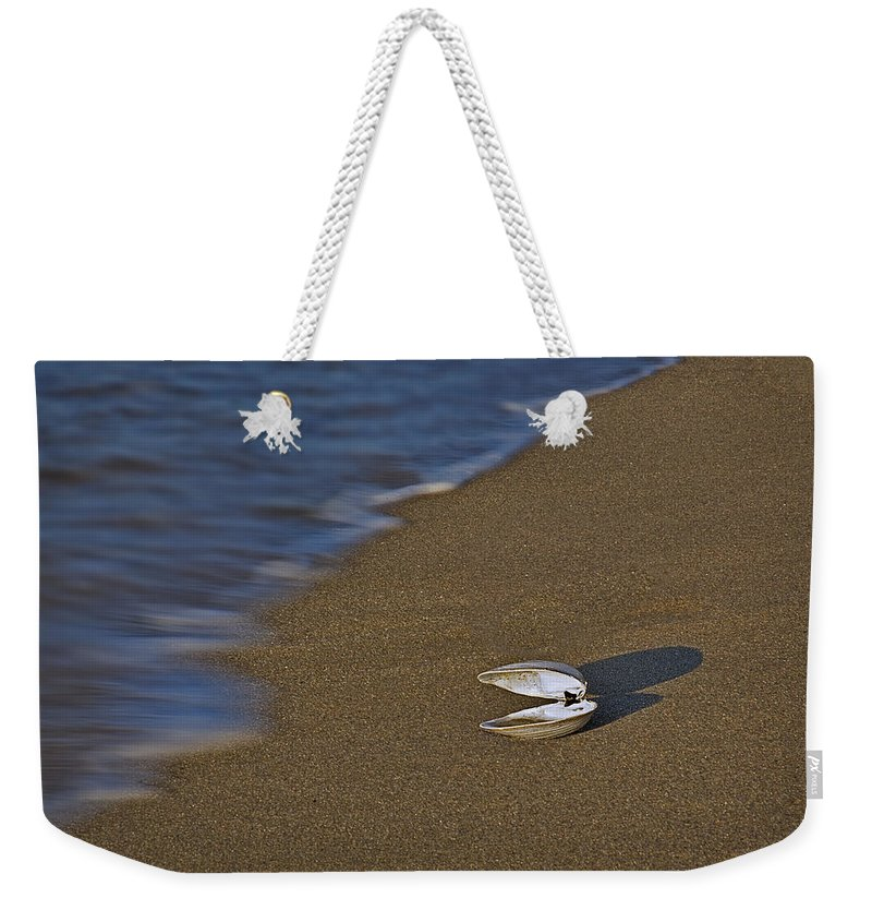 Sea Shell Weekender Tote Bag featuring the photograph Shell By The Shore by Susan Candelario