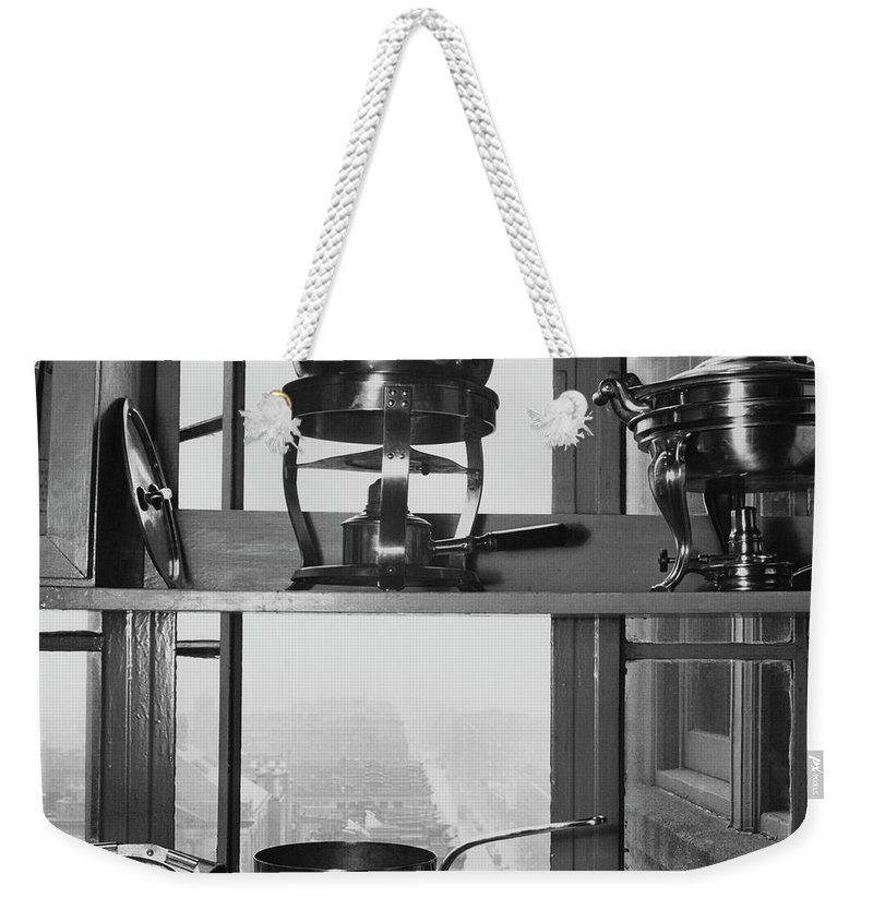 Kitchen Weekender Tote Bag featuring the photograph Shelves In Front Of A Window In Vivian Roome's by Luis Lemus