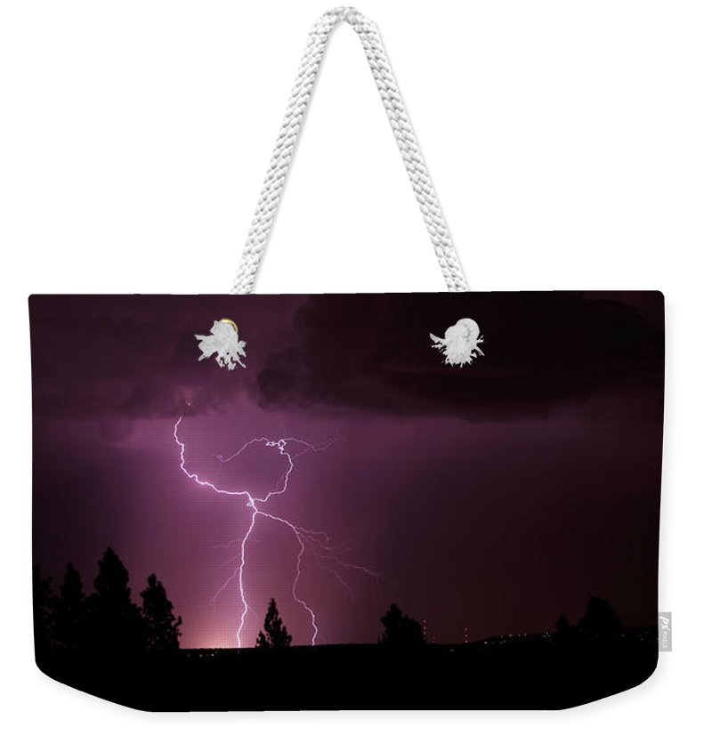 Lightning Weekender Tote Bag featuring the photograph She's Alive by Craig Dykstra