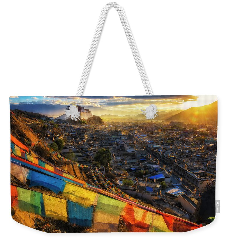 Chinese Culture Weekender Tote Bag featuring the photograph Shigatse Monastery by Ratnakorn Piyasirisorost