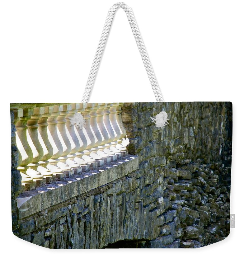 Bridge Weekender Tote Bag featuring the photograph Shining Through by Charlie Brock