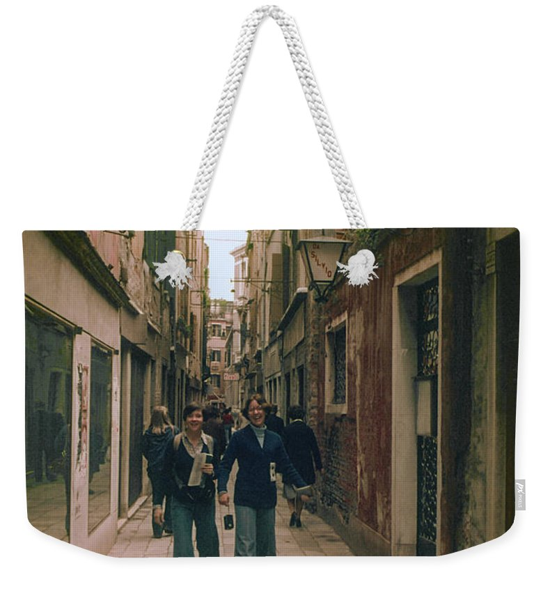 Venice Street Cobblestone Streets Cobblestones Store Stores Shop Shops Person Persons People Women Woman Building Buildings Structure Structures Architecture City Cities Cityscape Cityscapes Italy Weekender Tote Bag featuring the photograph Shopping by Bob Phillips