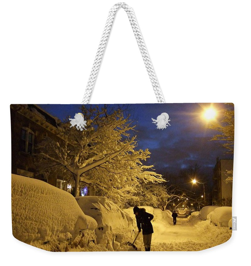 Weekender Tote Bag featuring the photograph Shoveling Away by Katerina Naumenko