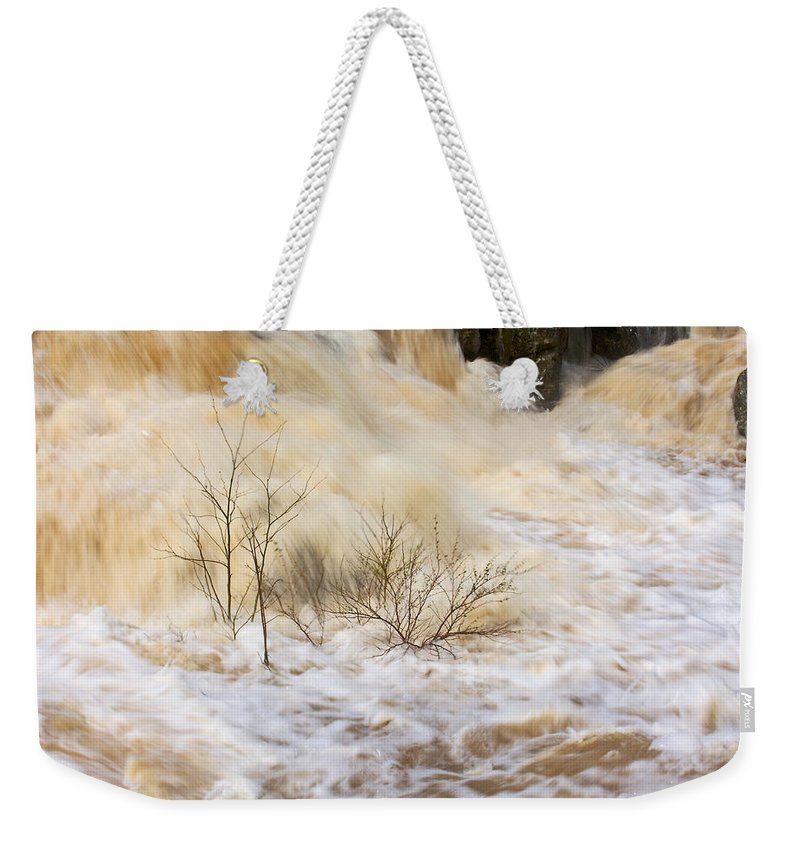 Great Falls Weekender Tote Bag featuring the photograph Shrubs In The Rapids #2 by Stuart Litoff