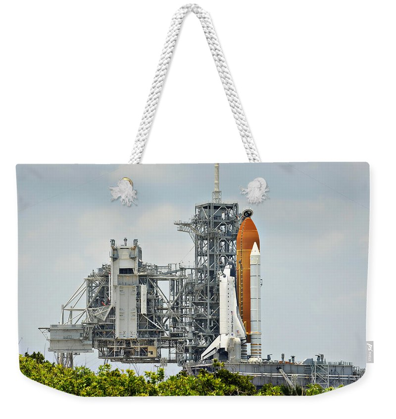 Sts Weekender Tote Bag featuring the photograph Shuttle Endeavour Is Prepared For Launch by Ricky Barnard
