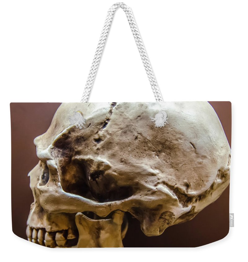 Appearance Weekender Tote Bag featuring the photograph Side Profile View Of Human Skull  by Alex Grichenko