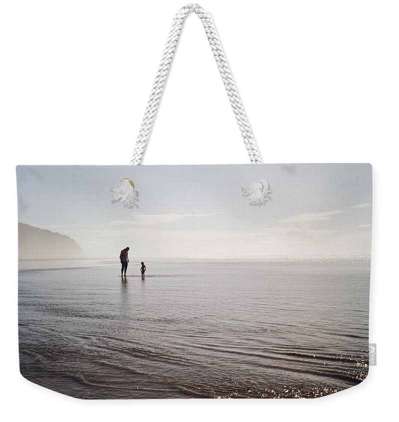 Child Weekender Tote Bag featuring the photograph Silhouettes Of Father And Child At Beach by Danielle D. Hughson