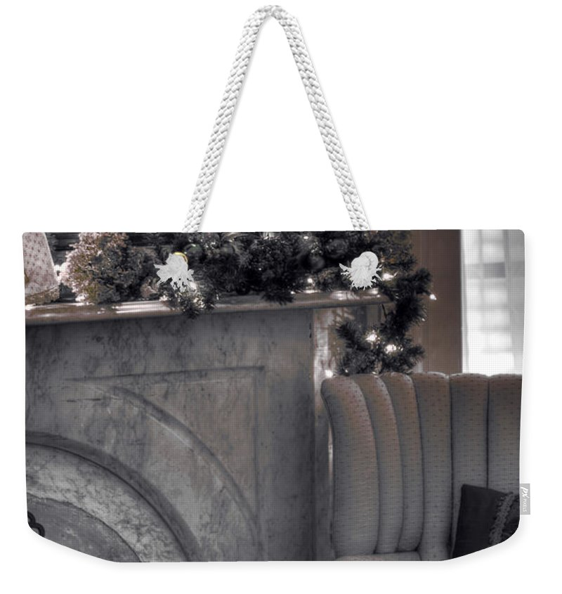 Chair; Fireplace; Mirror; Garland; Living Room; Sitting Room; Mantle; Hearth; Sofa; Pillow; Vintage; Silver; Christmas; Season; Seasonal; Light; Window; Drapes; Interior; Inside; Indoors; Silver Screen; 1940s Weekender Tote Bag featuring the photograph Silver Screen by Margie Hurwich