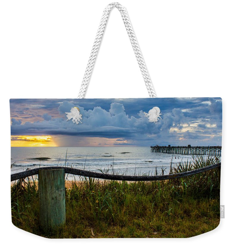 Weekender Tote Bag featuring the photograph Simple Flager by Tyson Kinnison