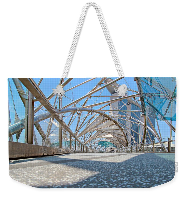 Artscience Weekender Tote Bag featuring the photograph Singapore Double Helix Bridge And Marina Bay Sands With Skypark by Paul Fell