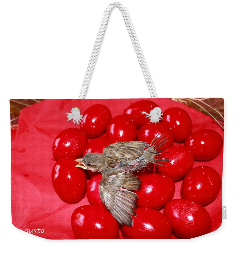 Augusta Stylianou Weekender Tote Bag featuring the photograph Singing Over Red Eggs by Augusta Stylianou
