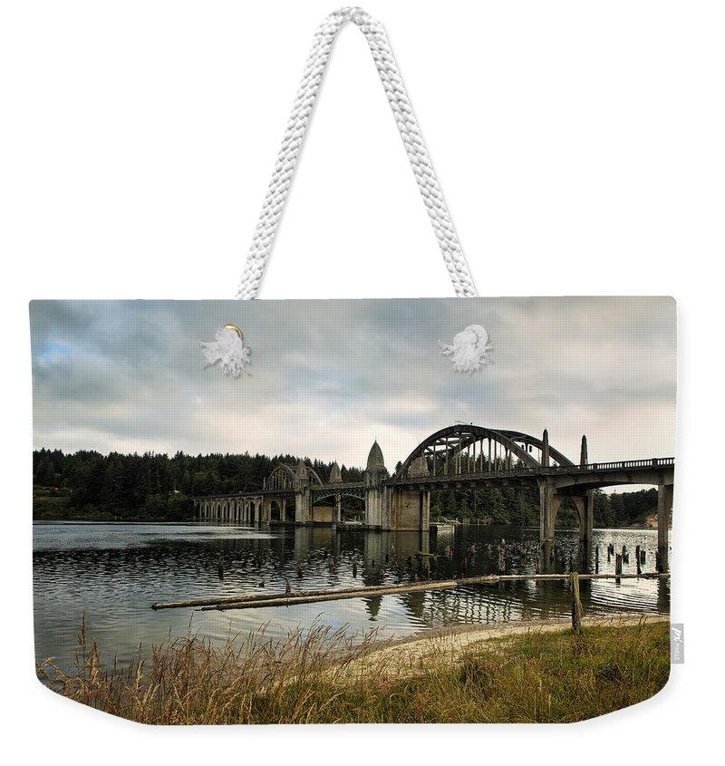 Siuslaw Bridge Weekender Tote Bag featuring the photograph Siuslaw River Bridge by Belinda Greb
