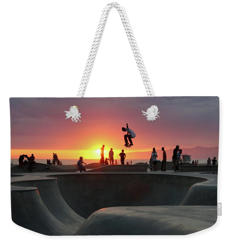 Expertise Weekender Tote Bag featuring the photograph Skateboarding At Venice Beach by Mgs