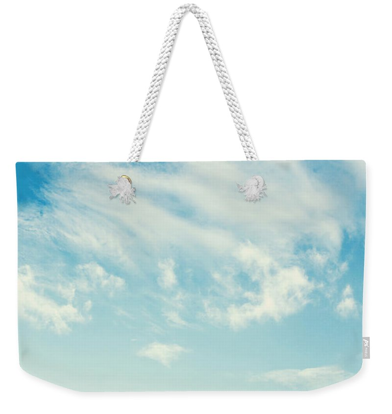 Sky Weekender Tote Bag featuring the photograph sky by Dan Radi