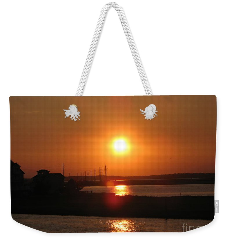 Sunset Weekender Tote Bag featuring the photograph Sky On Fire Over Chincoteague Island by Christiane Schulze Art And Photography