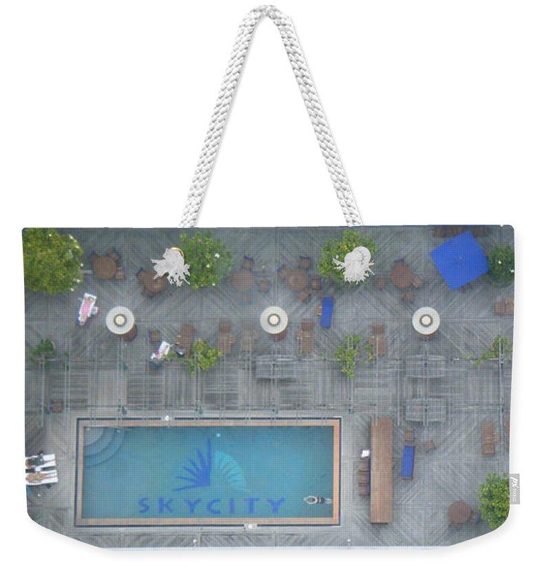 Swimming Pool Weekender Tote Bag featuring the photograph Skycity Pool by Ingrid Van Amsterdam