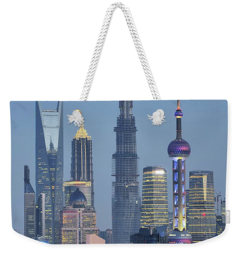 Built Structure Weekender Tote Bag featuring the photograph Skyscraper City by Wei Fang