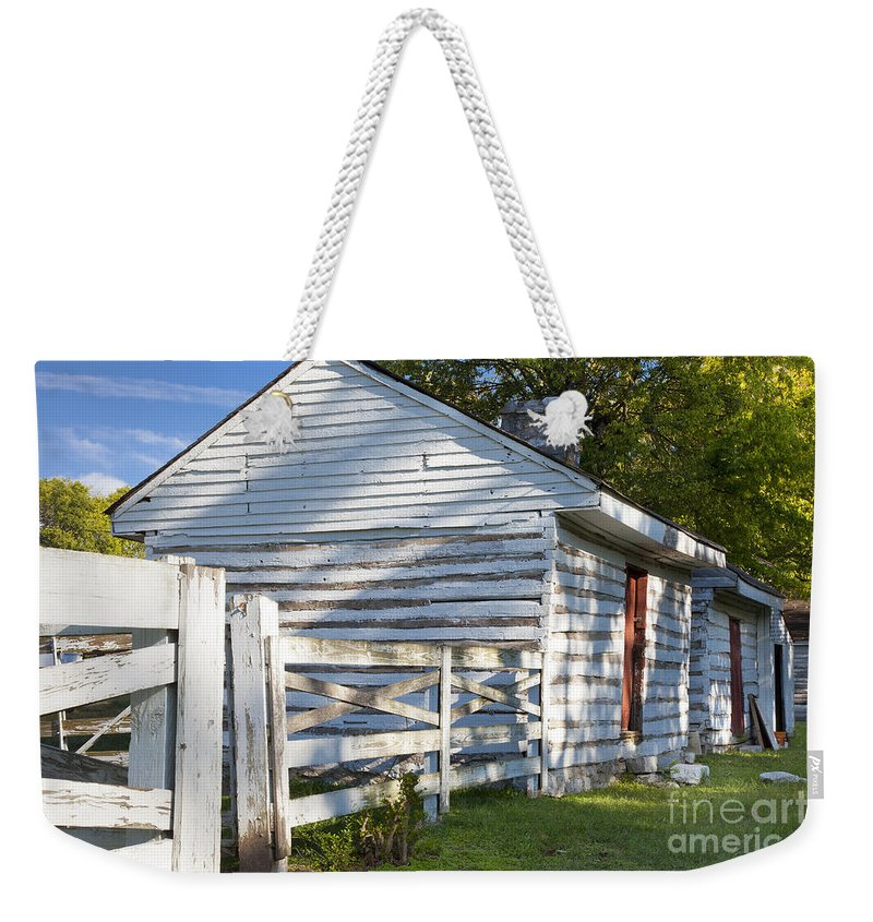 Slave Weekender Tote Bag featuring the photograph Slave Huts On Southern Farm by Brian Jannsen