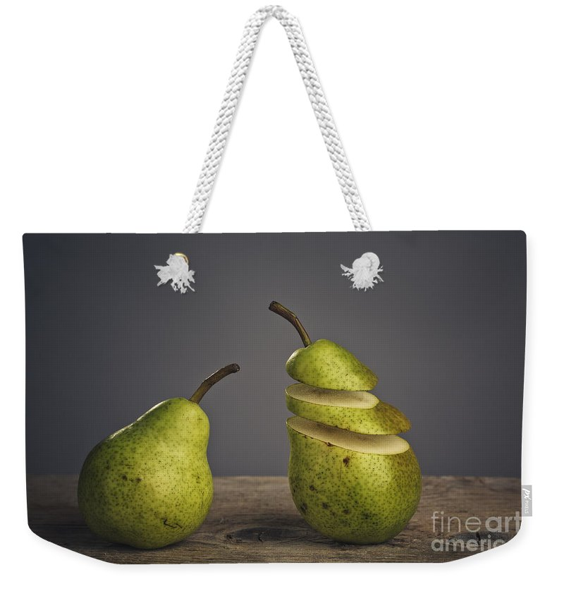 Pear Weekender Tote Bag featuring the photograph Sliced by Nailia Schwarz