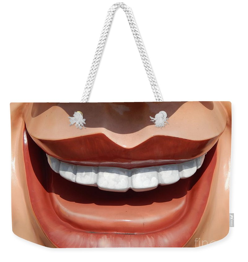 Nola Weekender Tote Bag featuring the photograph New Orleans Smile Though Your Heart Is Aching by Michael Hoard